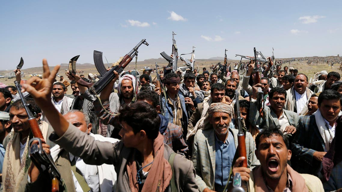 Followers of the Shi'ite Houthi group brandish their rifles during a gathering near Sanaa August 20, 2014.