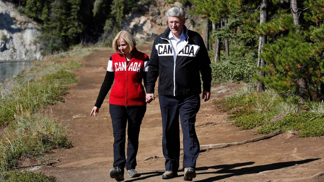 Canada's Prime Minister Stephen Harper (R) and his wife Laureen tour Miles Canyon near Whitehorse, Yukon August 21, 2014.