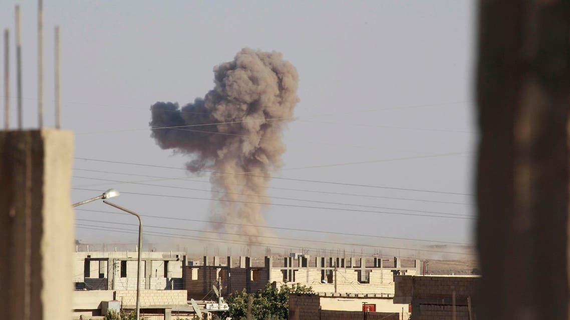 Smoke rises during what activists said was an air raid by warplanes operated by forces of Syria's President Bashar Al-Assad around al-Tabqa military base at a government-controlled airport that is surrounded by militants, west of Raqqa city, August 21, 2014. (Reuters)