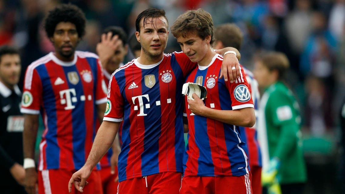 Bayern Munich's Mario Goetze (C) and teammate Gianluca Gaudino (R) celebrate their victory over Preussen Muenster after their German soccer cup (DFB Pokal) first round soccer match in Muenster August 17, 2014.  (Reuters)