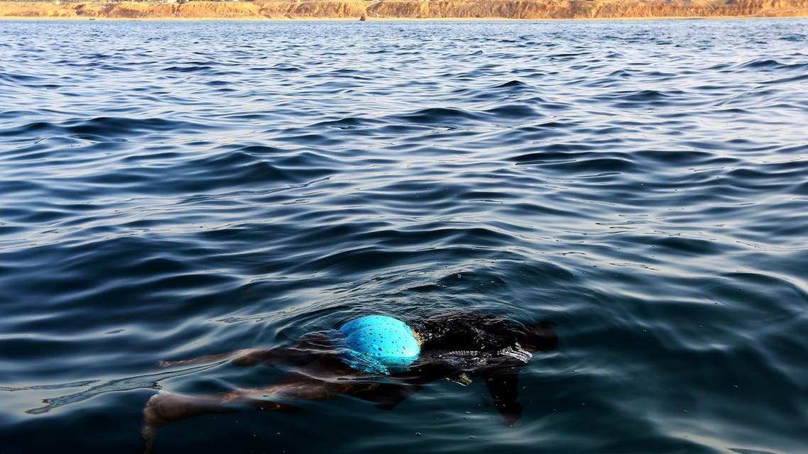 The body of an illegal immigrant floats on the water after a boat carrying 200 illegal migrants from sub-Saharan Africa sank off the shores of al-Qarbole, some 60 kilometers east of the Libyan capital Tripoli, on August 22, 2014. (AFP)