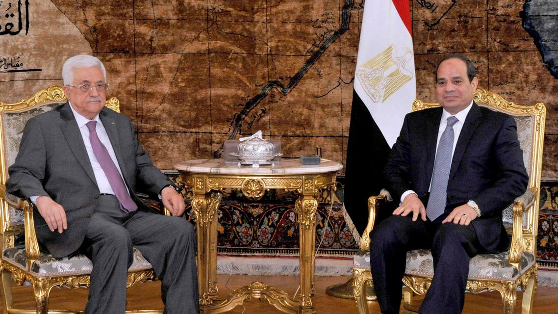 Egyptian President Abdel Fattah al-Sisi (R) meets with Palestinian President Mahmoud Abbas at the Presidential Palace in Cairo August 23, 2014, seen in this handout photo provided by the Egyptian Presidency.