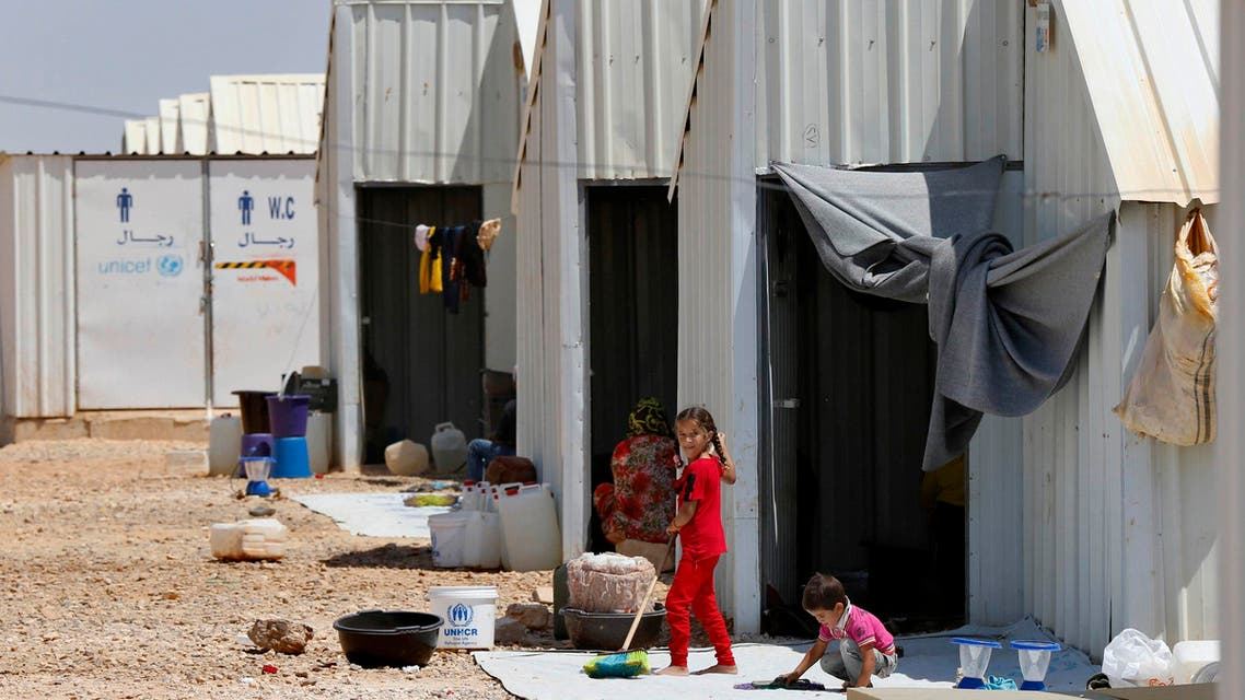 Syrian refugee children play in front of their family residences at Azraq refugee camp near Al Azraq, east of Amman, August 19, 2014.