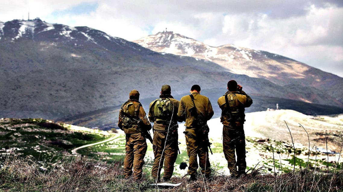Israeli soldiers deployed on the border with Syria keep watch from the Israeli side of the border near the Druze village of Majdal Shams. (File photo: AFP)