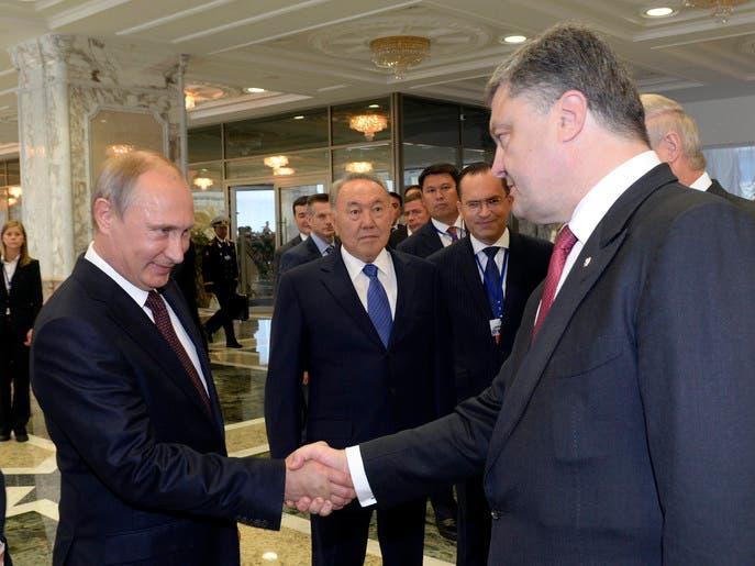 اتهامات متبادلة بين بوتين ورئيس أوكرانيا