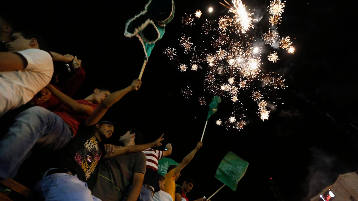 Palestinians release fireworks as they celebrate what they said was a victory by Palestinians in Gaza over Israel following a ceasefire, in the West Bank city of Ramallah August 26, 2014. reuters