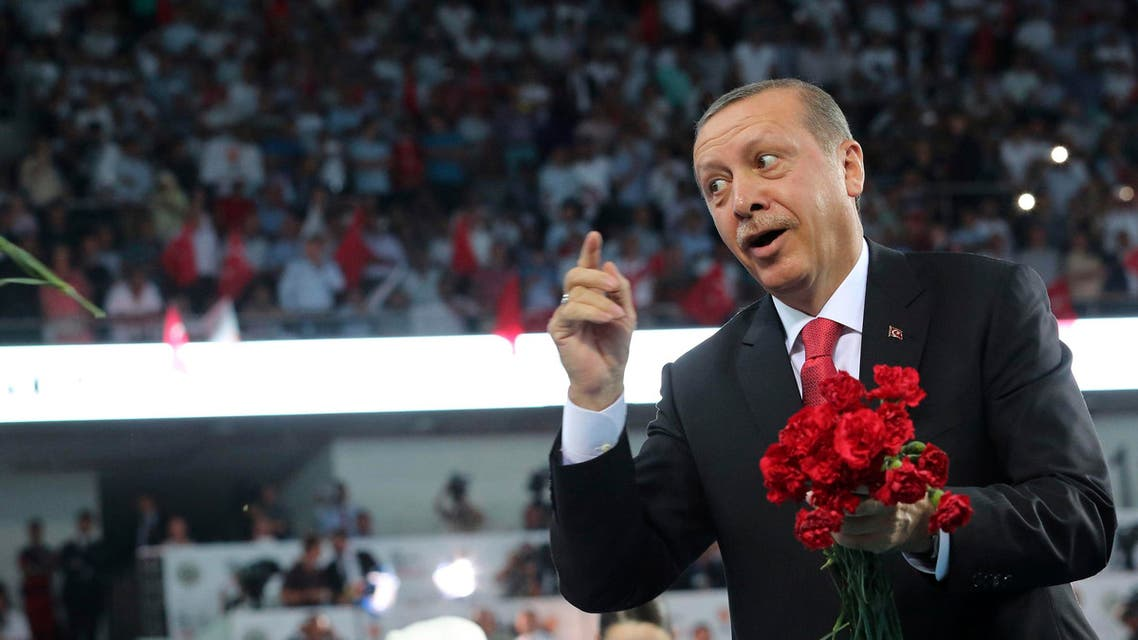 Turkey's Prime Minister Tayyip Erdogan greets his supporters upon arriving at the Extraordinary Congress of the ruling AK Party (AKP) to choose a new leader of the party, ahead of Erdogan's inauguration as president, in Ankara August 27, 2014. (Reuters)