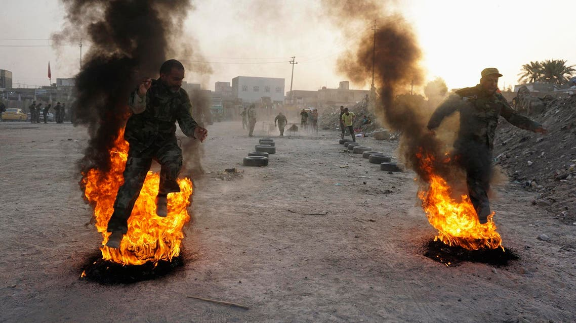 Shi'ite volunteers, who have joined the Iraqi army to fight against ISIS militants take part in field training in Najaf, August 20, 2014. (Reuters)