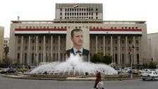 Syria's Assad forms government, 11 new ministers