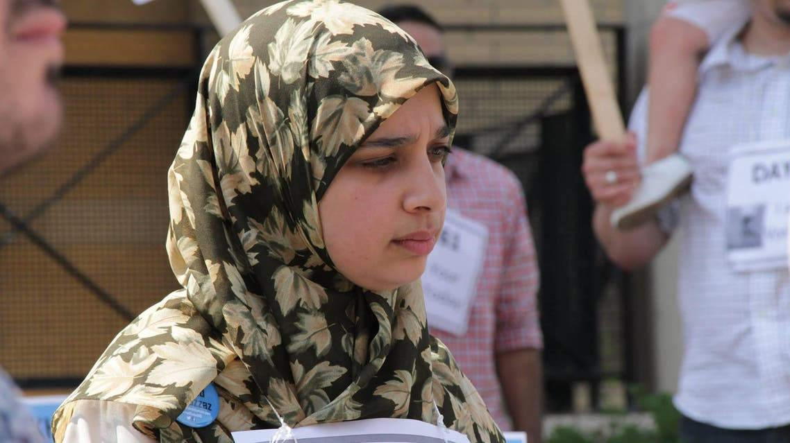 Sarah Attia at a rally in Mississauga, Canada calling for her husband's release, June 30, 2014. (Courtesy of: Facebook)