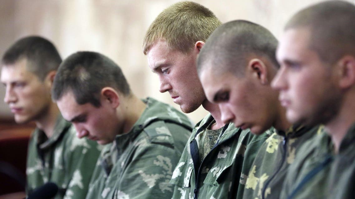 Russian paratroopers captured by Ukrainian forces near the village of Dzerkalne, Donetsk region, some 20 to 30 kilometres from the Russian border. (AFP)