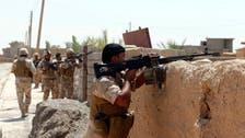 Militants burn three Iraq oil wells as Iraq's Kurds attack