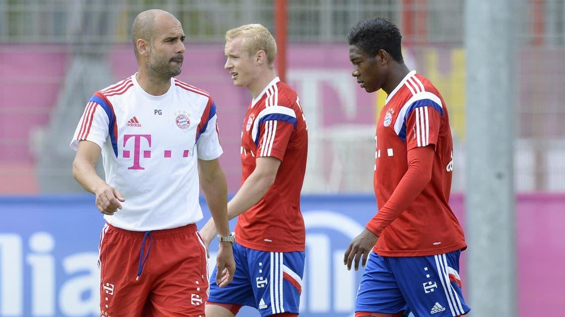 Bayern Munich's Spanish head coach Pep Guardiola, midfielder Sebastian Rode and Austrian midfielder David Alaba are pictured during a training session of German first division Bundesliga football club FC Bayern Munich in Munich. (AFP)