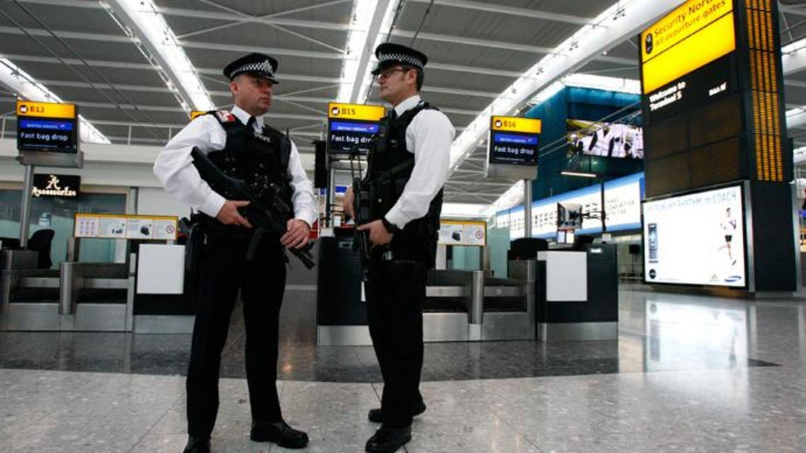 Police officers patrol the check-in hall in the new Terminal 5 building at London's Heathrow Airport (Reuters)