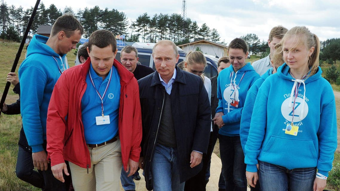 Russia's President Vladimir Putin (C) attends the youth forum 'Seliger-2014' at the Seliger lake, northern Russia, on August 29, 2014. (AFP)