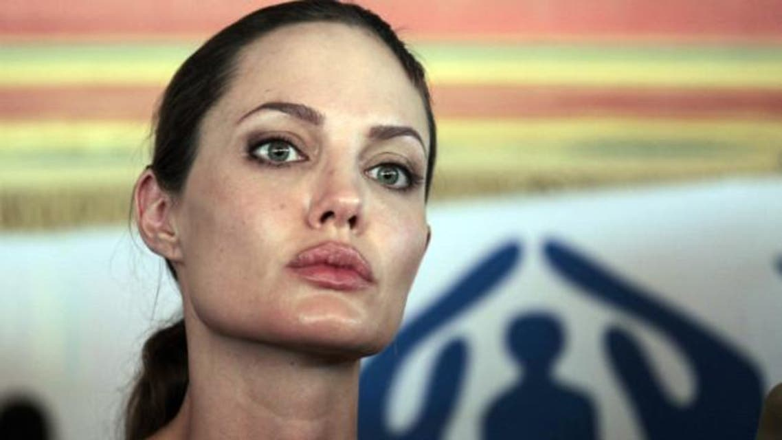 Jolie briefs the press during her visit to the Za'atri camp near Jordan's border with Syria in 2012. (AFP)