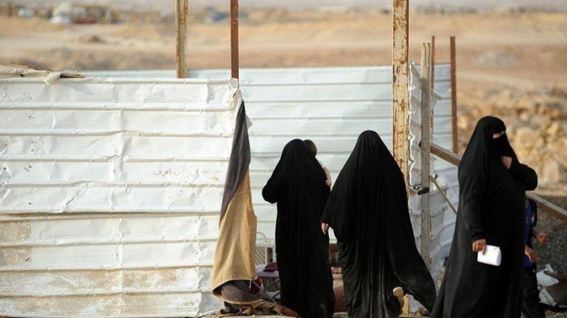 Stateless women stand at a makeshift home in a poor neighbourhood, east of the Saudi capital of Riyadh, on July 10, 2013. afp
