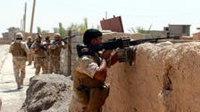 Iraqi, Kurdish forces try to end ISIS siege of town