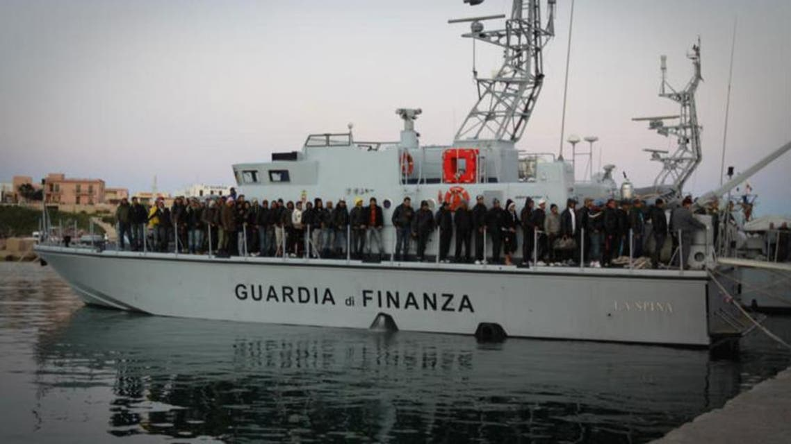 Migrants arriving from Tunisia and Libya aboard a Guardia Di Finanza boat after their own boat nearly sunk off the coast of Italy. (Photo courtesy: UN)