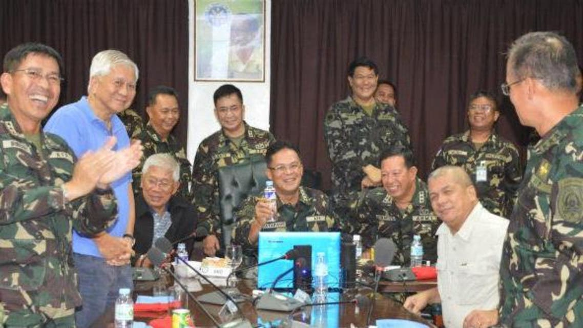Top defense and military officials cheer at Camp Aguinaldo on Sunday, Aug. 31, after the successful repositioning of Filipino peacekeepers. (Photo: CPL Palima, CRS-AFP)