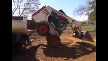 Watch acrobatic bobcat machine launch itself onto truck