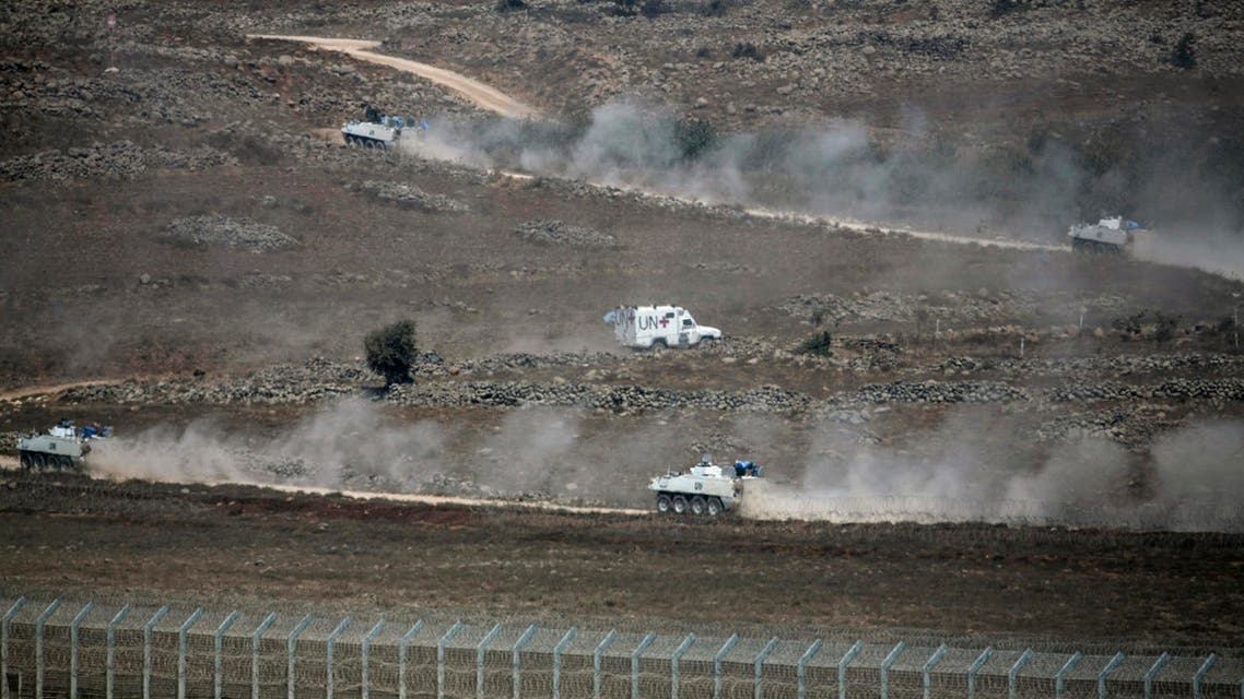 U.N. vehicles drive in Syria, near the border fence with the Israeli-occupied Golan Heights August 31, 2014. (Reuters)