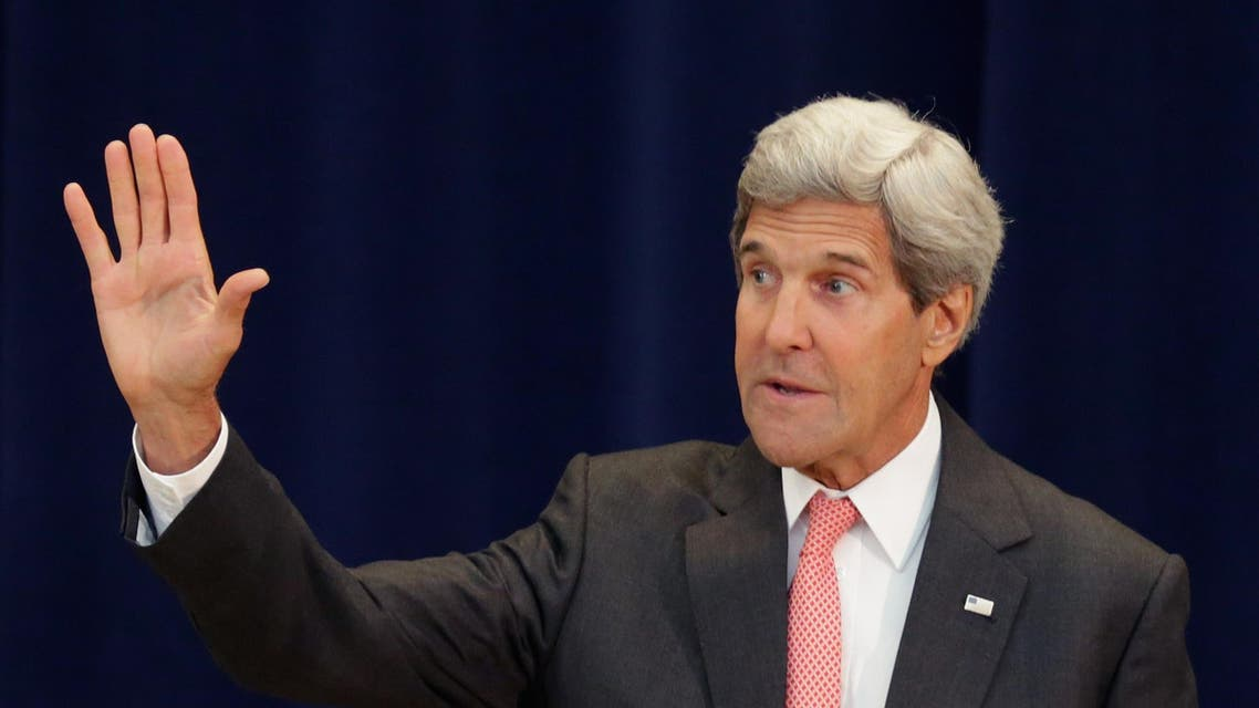 U.S. Secretary of State John Kerry waves goodbye during a ceremony to honor the appointment of Shaarik Zafar to be Special Representative to Muslim Communities in the Acheson Auditorium at the State Department September 3, 2014 in Washington, DC. (AFP)