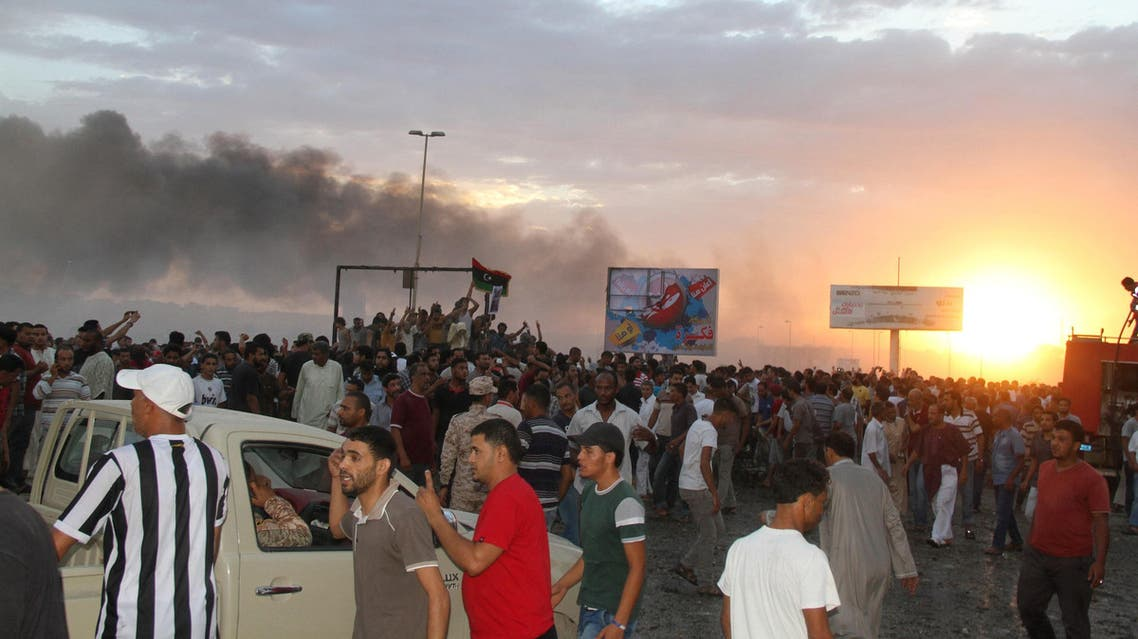 People gather at the scene of a Libyan war plane crash in the eastern city of Tobruk September 2, 2014. (Reuters)