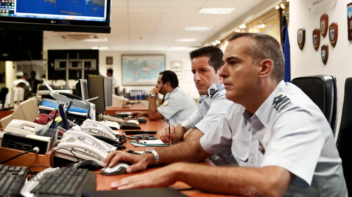 Greek coast guard officers work at the Maritime Rescue Coordination Center at the Shipping Ministry in Piraeus, near Athens, September 4, 2014. (Reuters)