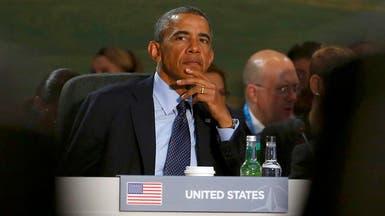 """""""أوباما وإيبولا"""" على نفس الطاولة"""