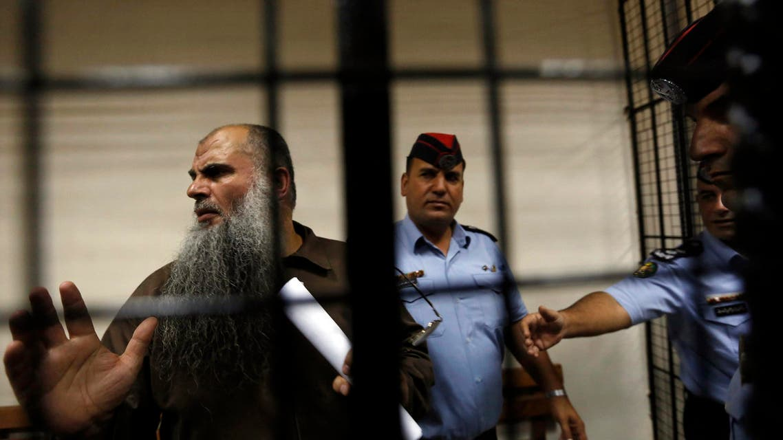 Radical Muslim cleric Abu Qatada (L) speaks to the media after his hearing at the State Security Court in Amman September 7, 2014. (Reuters)
