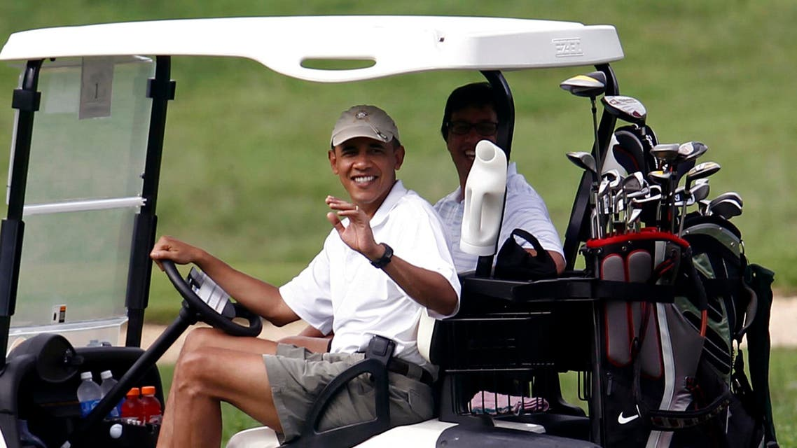 U.S. President Barack Obama waves from a golf cart at the Mid-Pacific Country Club in Kailua, Hawaii Reuters