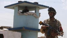 Militants assault defiant Iraq town, kill 18