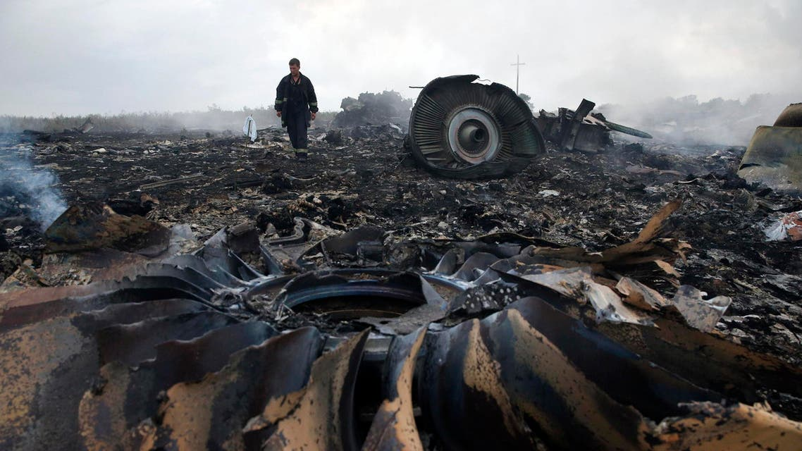 An Emergencies Ministry member walks at a site of a Malaysia Airlines Boeing 777 plane crash near the settlement of Grabovo in the Donetsk region in this July 17. (Reuters)