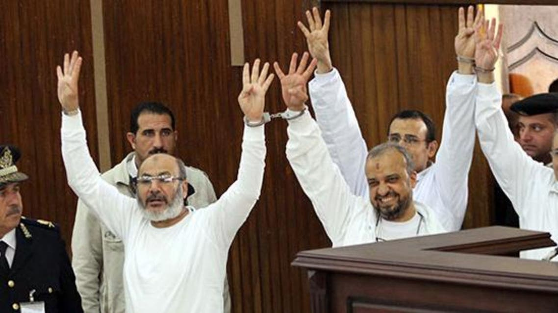 Mohammad el-Beltagy and cleric Safwat Hegazy were convicted of detaining and attempting to kill the policemen