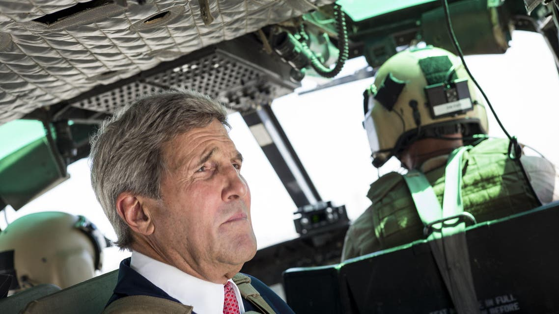S Secretary of State John Kerry rides in a helicopter September 10, 2014 in Baghdad.  (AFP)