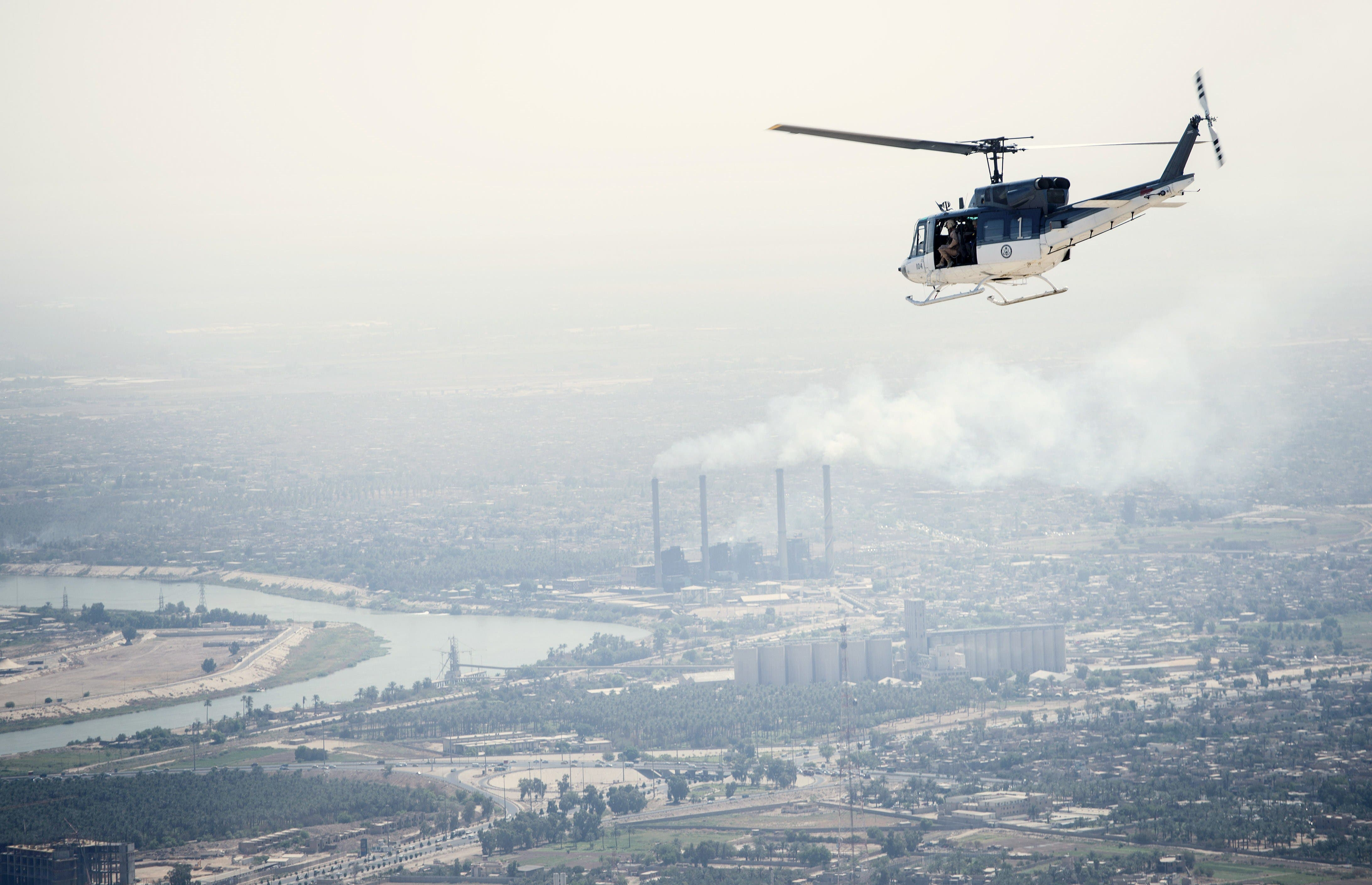 A U.S. State Department helicopter flies over Baghdad on September 10, 2014. (AFP)