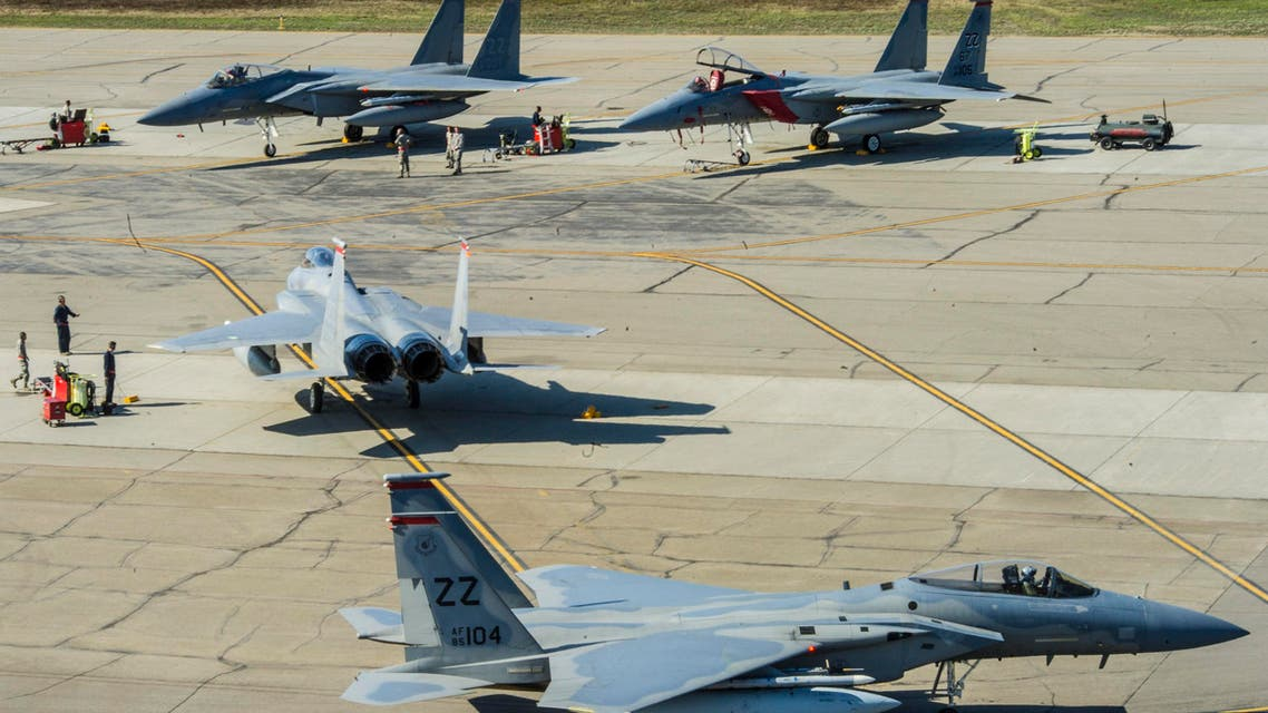 U.S. Air Force F-15 Eagles assigned to the 67th Fighter Squadron, Kadena Air Base, Japan, taxi during RED FLAG-Alaska 14-1 May 14, 2014, Eielson Air Force Base, Alaska. (U.S. Air Force photo by Senior Airman Joshua Turner/Released)