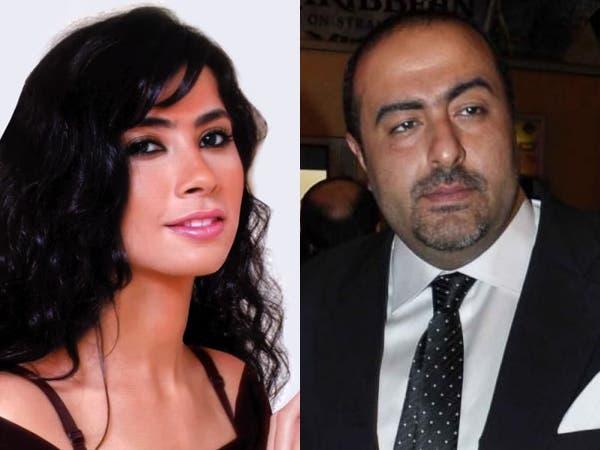 المخرج سامح عبد العزيز والفنانة روبي