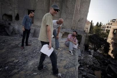 Palestinian filmmaker Khalil Mozayen,second right, speaks with a crew member during a rehearsal for his new movie in Gaza City, Sept. 5, 2014. (Photo courtesy: AP)