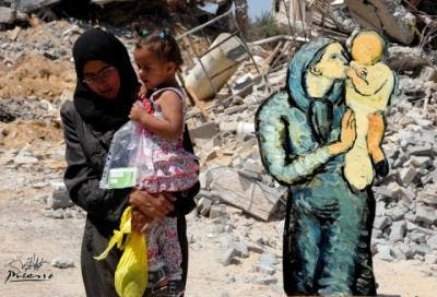 This image made available on Sunday, Sept. 7, 2014 by Palestinian artist Basel al-Maqosui, shows a collaboration of a famous painting by Spanish painter, Pablo Picasso, paired with a photograph taken by al-Maqosui of a woman carrying her child as she walks past damages after an Israeli Strike hit the Gaza Strip. (Photo courtesy: AP)