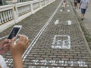 مدينة صينية تخصص أرصفة لاستخدام الهواتف أثناء السير
