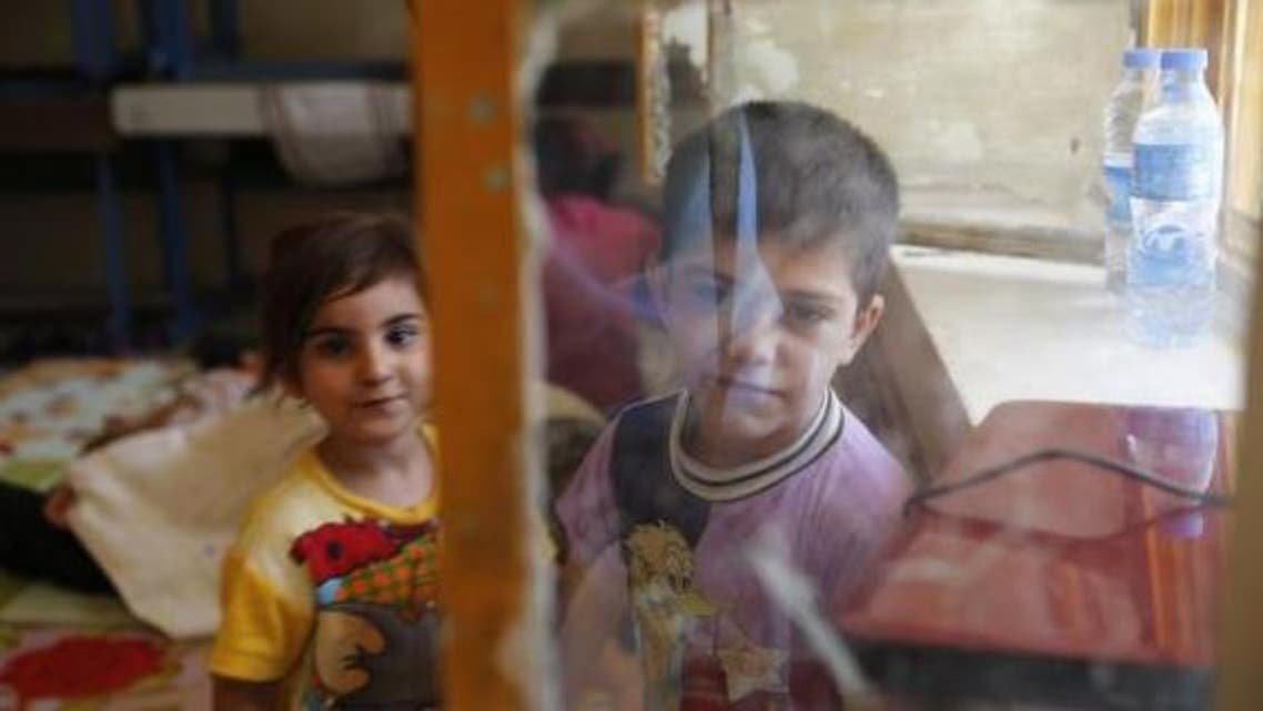 Children of a Christian family, who fled from the violence in Mosul stay at a school in Erbil, in Iraq's Kurdistan region June 27, 2014.  (Reuters)