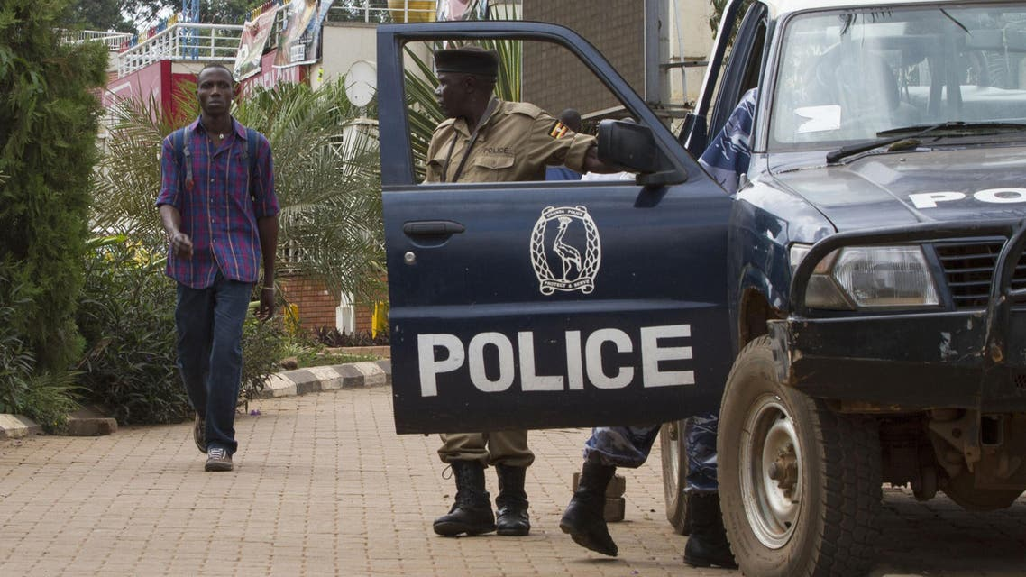 Ugandan police stand guard outside a popular shopping mall in the capital Kampala on September 14, 2014. (AFP)