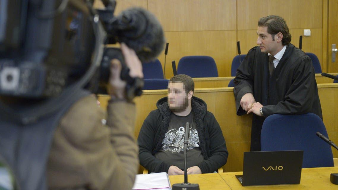 German alleged jihadist Kreshnik B (C) waits next to his lawyer Mutlu Guenal (L) as he arrives at the higher regional court in Frankfurt. (AFP)