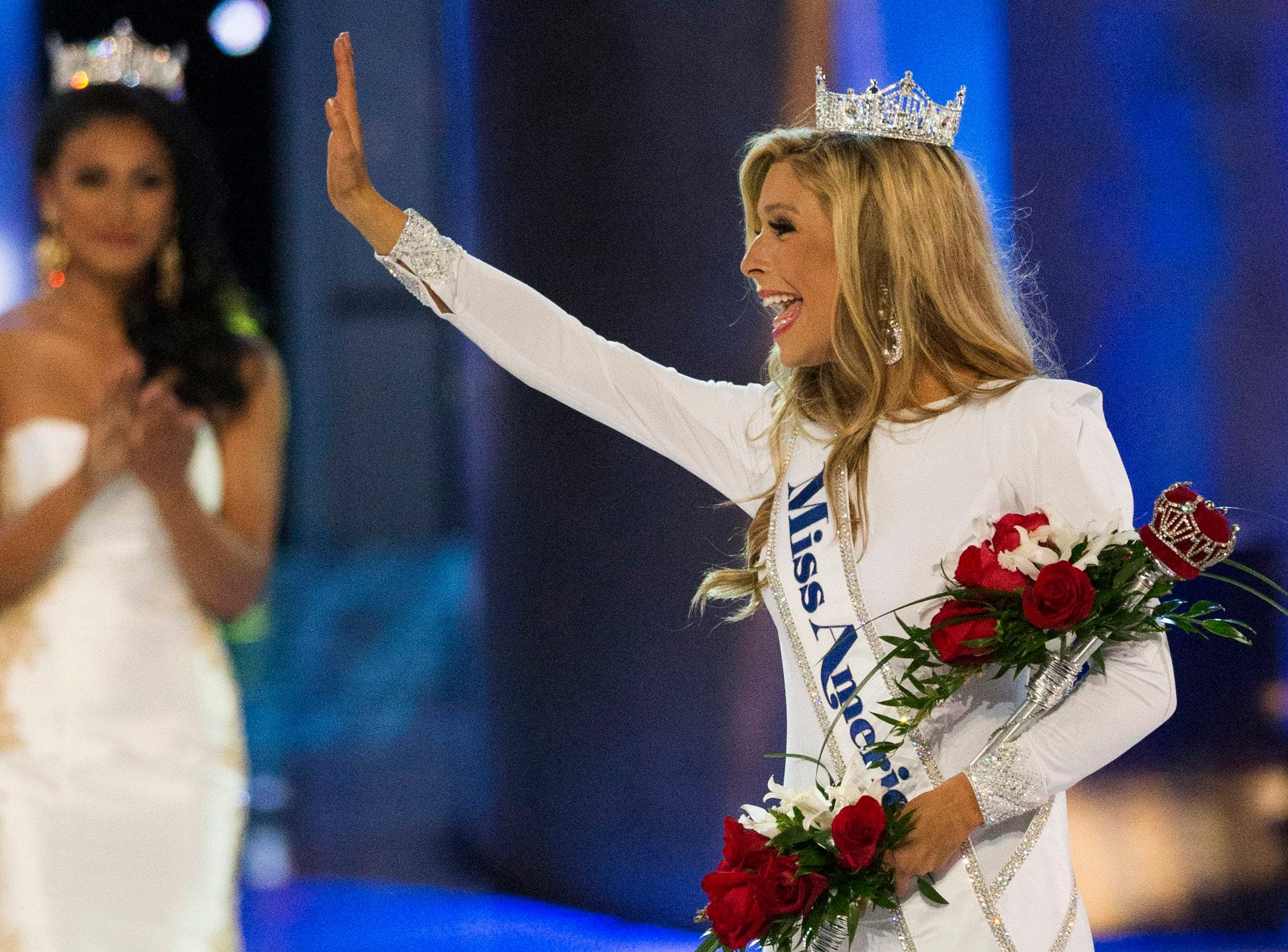 Miss New York Kira Kazantsev (R) waves near Miss America 2014 Nina Davuluri after she was crowned as the winner of the 2015 Miss America Competition in Atlantic City, New Jersey September 14, 2014. (Reuters)