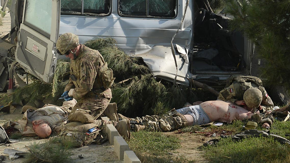 Foreign troops give first aid to foreign victims at the site of a suicide attack in Kabul on September 16, 2014. (AFP)