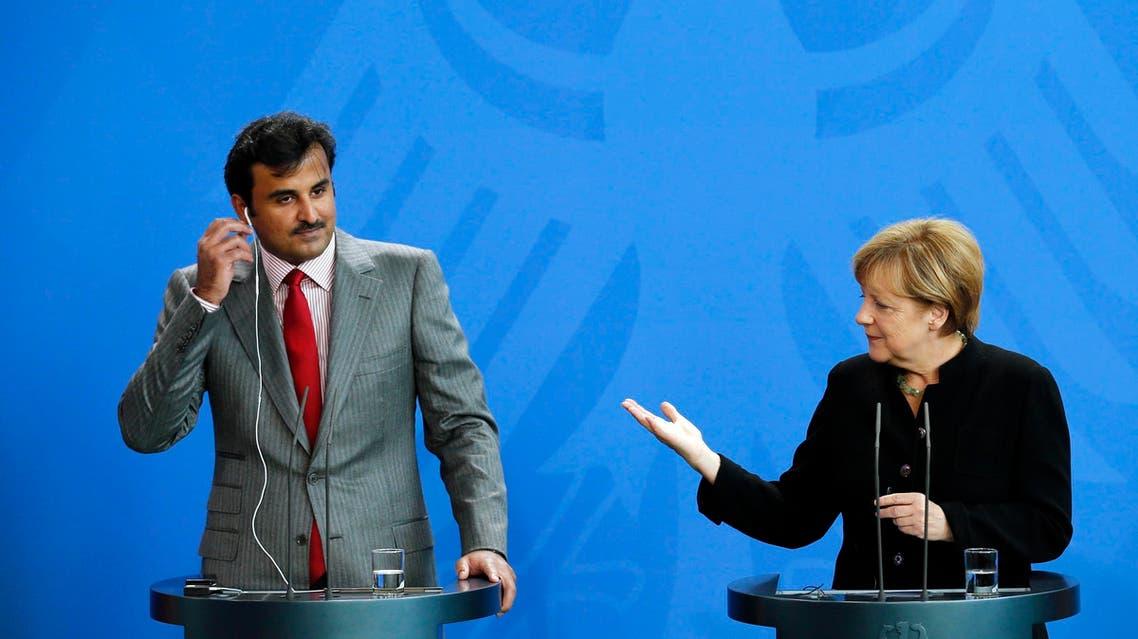 ميركل وأمير قطر