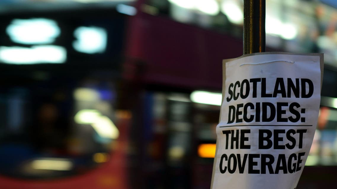 A sign advertises a local newspaper as polling stations open their doors in Edinburgh, Scotland, on September 18, 2014. (AFP)