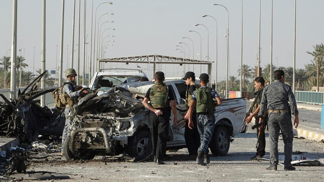 Iraqi security forces inspect the site of a suicide bombing on a bridge in Ramadi, west of Baghdad, September 17, 2014. (Reuters)